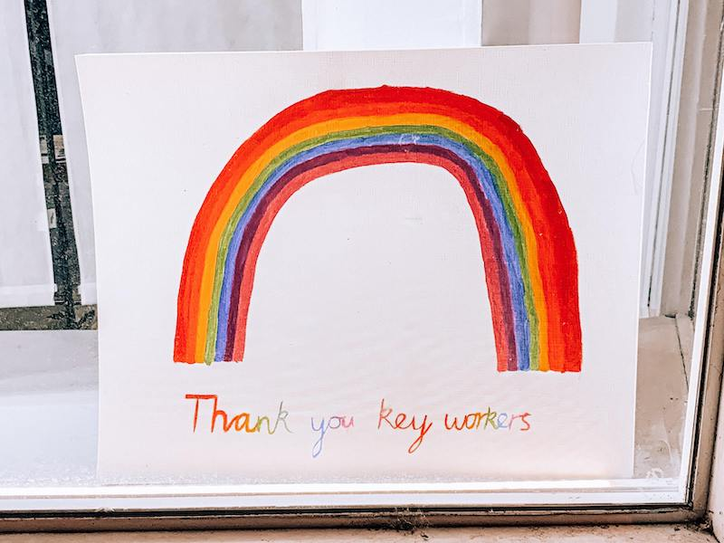 Child's colourful drawing on a rainbow accompanied by the writing: thank you key workers