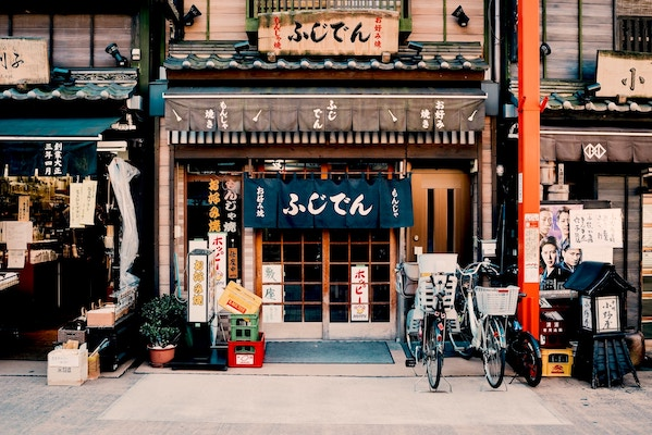 Japanese store front with bicycles and posters outside