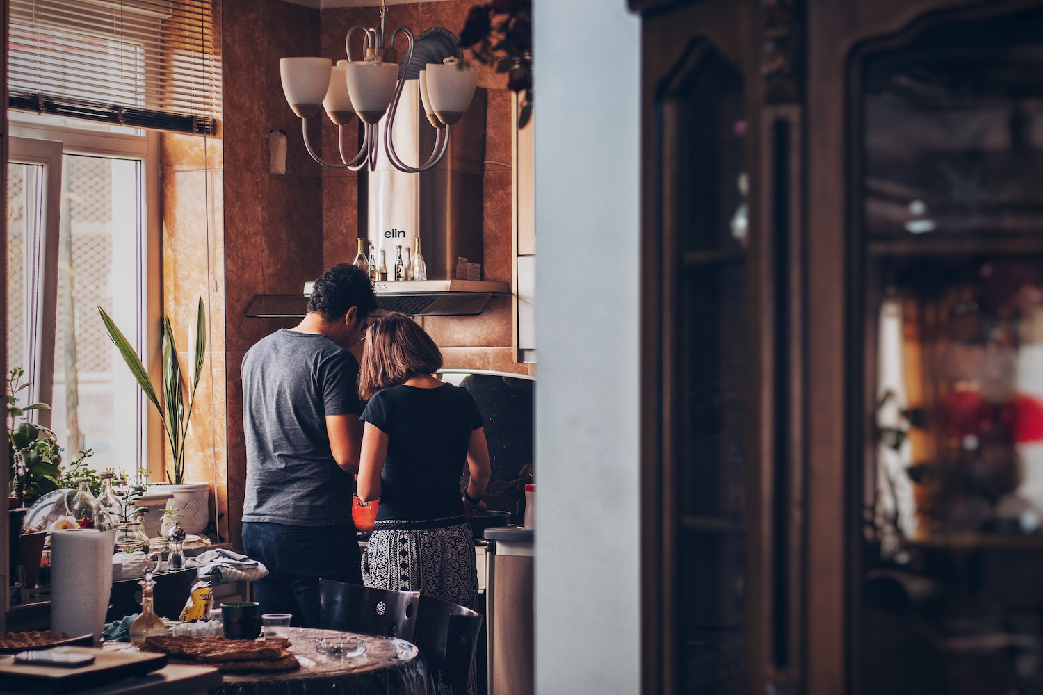 couple cooking together in their home kichen