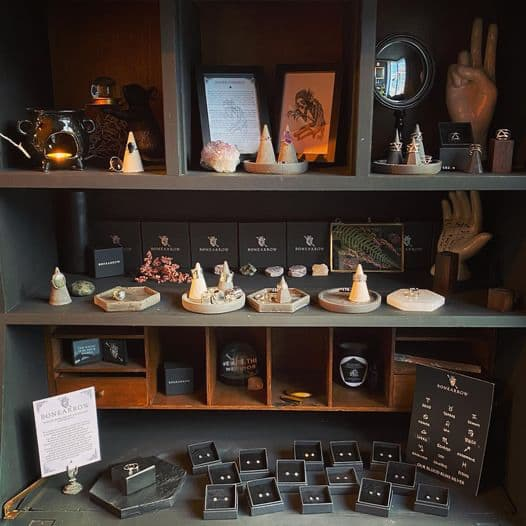 Dark shelves in shop with dozens of pieces of handmade jewelry