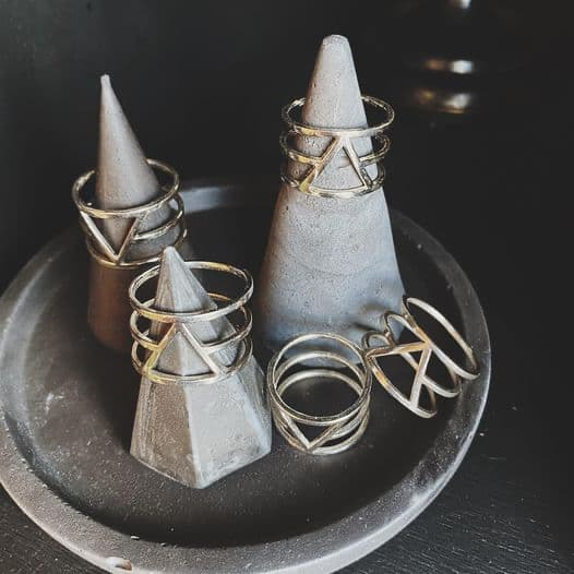 Various geometric-styled rings with triangle patterns