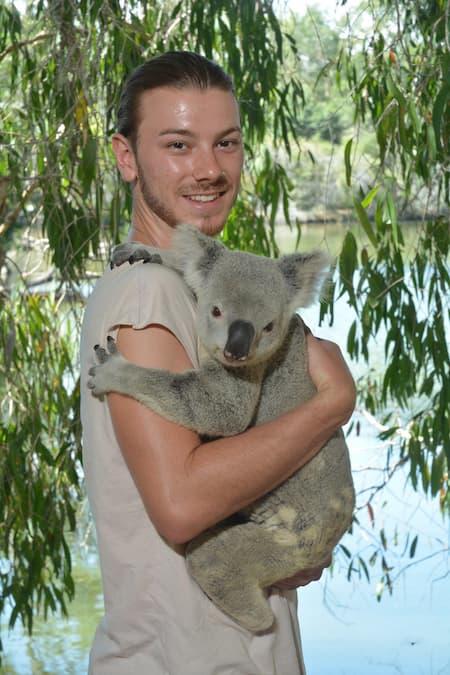 DAYMADE winner, Sam, holding a koala bear in Australia